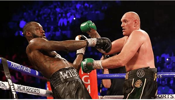 Foto Британец Тайсон Фьюри победил американца Деонтея Уайлдера в бое-реванше и отобрал титул чемпиона мира по боксу в тяжелом весе по версии WBC 1 23.06.2021