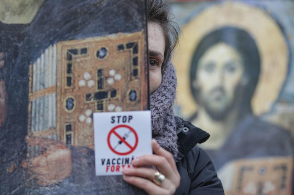 Foto Жители Румынии вышли на массовые акции протестов, связанные с ограничениями из-за пандемии COVID-19 2 29.07.2021